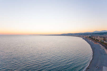 Photo for Nice beach day landscape, France.  Nice beach and famous Walkway of the English, Promenade des Anglais. Famous French touristic town - Royalty Free Image