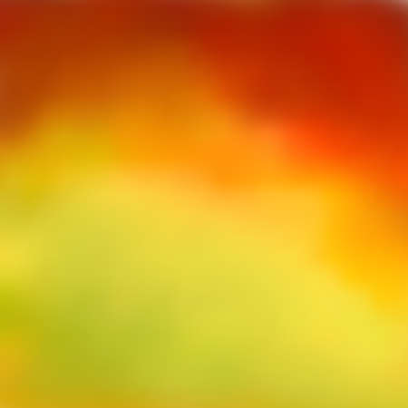 Bright abstract autumn background, beautiful blurred color transition from reds and browns to yellow-green. Fashionable and glamorous decoration of any of your bold advertising projects.