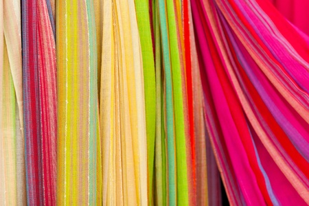 Closeup of colorful scarves. Shallow deep of focus.