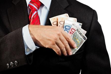 Businessman putting money in his pocket