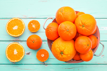 Oranges and Tangerines in retro colander.
