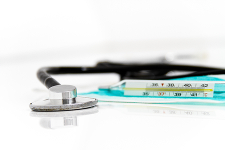 Photo of the Set for flu treatment, thermometer, nasal sprays, protective surgical mask, stethoscope, syringe...