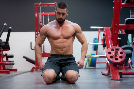 Photo for Fitness model Man posing in the gym. Handsome man with big muscles, posing at the camera in the gym. - Royalty Free Image