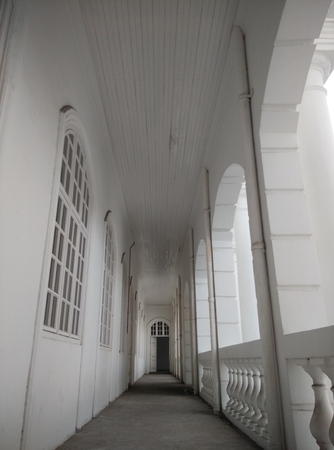 Hallway - white old historical British Colonial building, empty and abandoned.