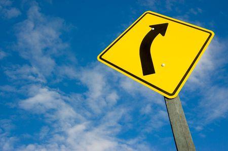 Photo pour road sign against a blue sky with clipping path. - image libre de droit