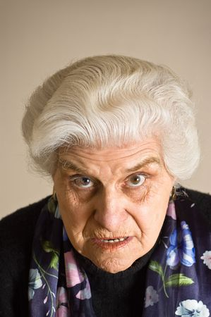Portrait of an angry mature woman, looking to cammera.