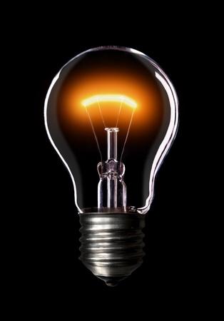 Light bulb turned on, black background.