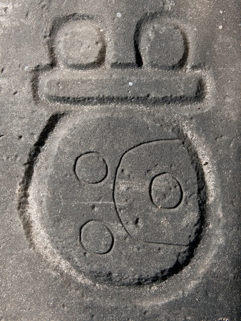 Mayan glyph carved in stone, Nim Li Punit archaeological site, Belize.
