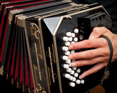 Playing the bandoneon, traditional tango instrument, Argentina.