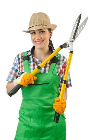 Girl with garden scissors on white