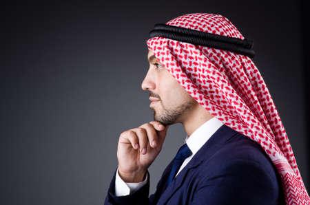 Arab businessman in dark studio