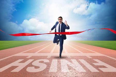 Photo pour Businessman on the finishing line in competition concept - image libre de droit