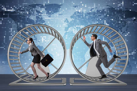Photo pour Business concept with pair running on hamster wheel - image libre de droit