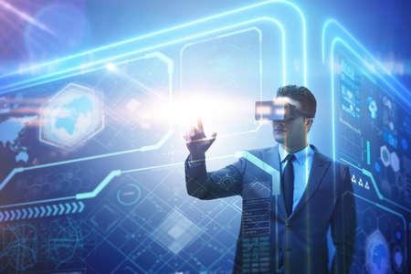 Photo pour Businessman in virtual reality trading on stock market - image libre de droit