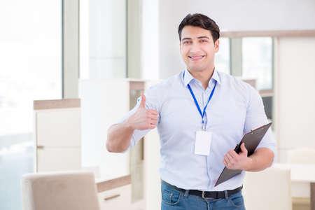 Photo pour Sales assistant in furniture store - image libre de droit