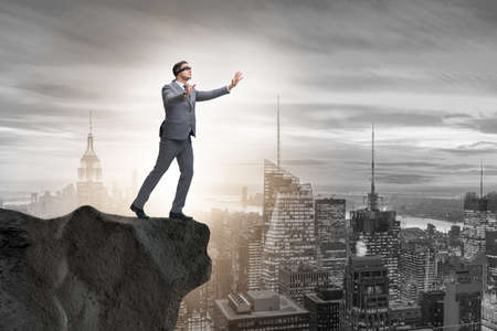 Photo for Blindfold businessman standing on tip of cliff - Royalty Free Image