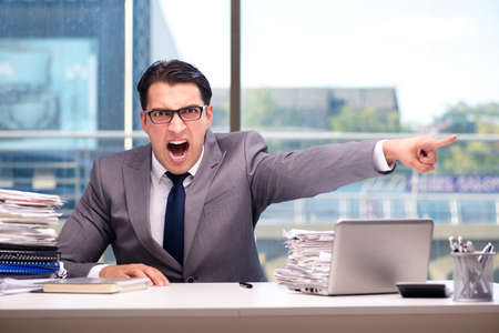 Photo for Angry businessman with too much work in office - Royalty Free Image