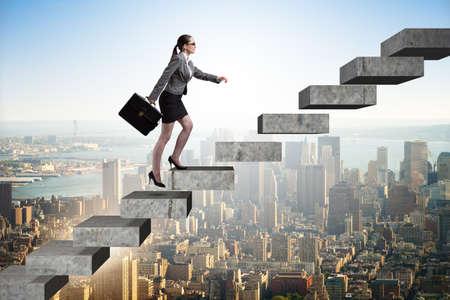 Photo pour Businesswoman climbing career ladder in business concept - image libre de droit