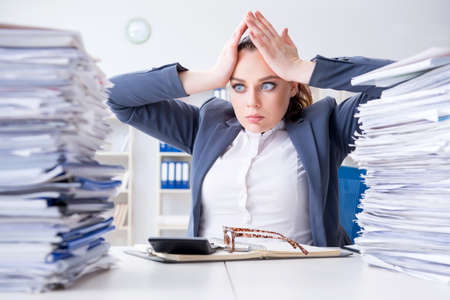 Photo pour Tired businesswoman with paperwork workload - image libre de droit