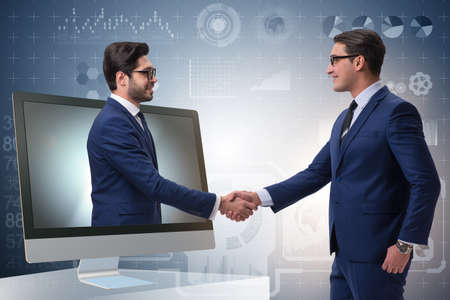 Photo for Telepresence concept with two businessman handshaking - Royalty Free Image