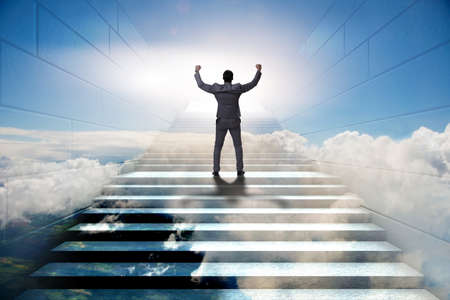 Foto de Businessman climbing up challenging career ladder in business concept - Imagen libre de derechos