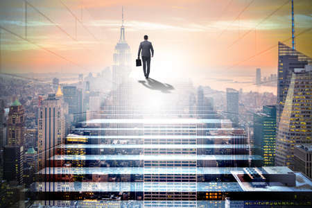 Photo pour Businessman climbing up challenging career ladder in business co - image libre de droit