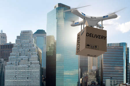 Photo pour Drone delivery concept with box in air - image libre de droit
