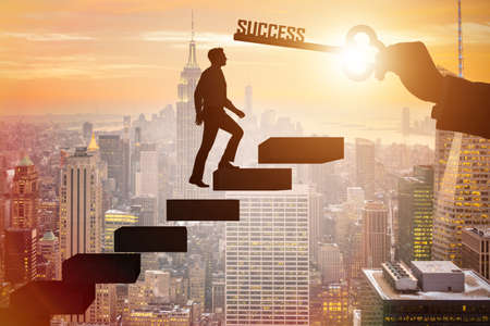 Photo for Businessman climbing the career ladder of success - Royalty Free Image