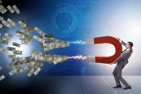 Photo pour Businessman catching dollars on horseshoe magnet - image libre de droit