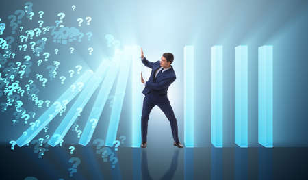 Foto de Businessman in domino effect business concept - Imagen libre de derechos