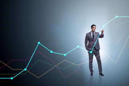 Foto de Businessman standing next to chart in business concept - Imagen libre de derechos