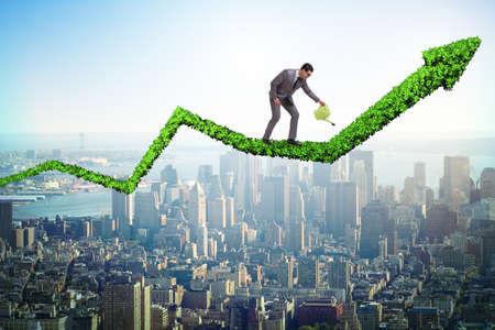 Foto de Businessman in investment concept watering financial line chart - Imagen libre de derechos