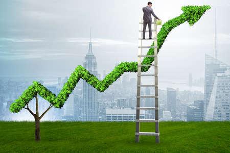 Photo pour Businessman in investment concept watering financial line chart - image libre de droit
