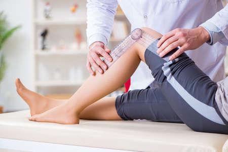 Foto de Doctor checking patients joint flexibility - Imagen libre de derechos