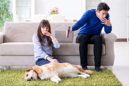 Photo pour Man having allergy from dog fur - image libre de droit
