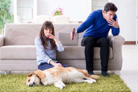 Photo pour Man having allergy from dog fur - image libre de droit