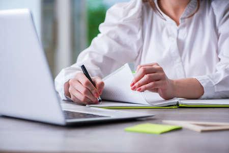 Foto de Woman hands working on computer at desk - Imagen libre de derechos