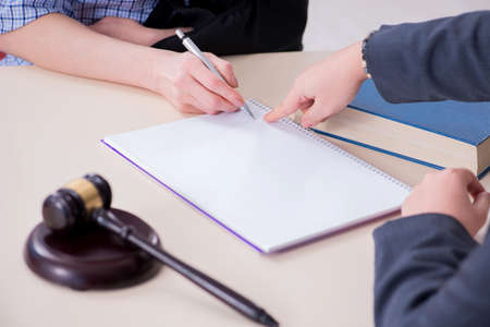 Photo for Injured employee visiting lawyer for advice on insurance - Royalty Free Image