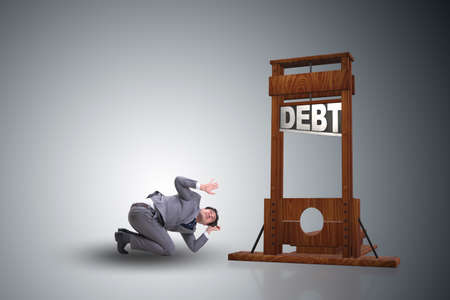 Businessman in heavy debt business concept