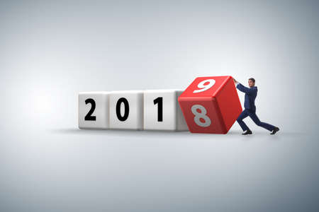 Foto de Businessman employee rotating cube to reveal number 2019 - Imagen libre de derechos