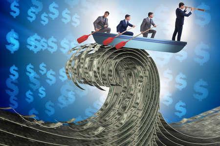 Foto de Businessman leading his team through wave of dollars - Imagen libre de derechos