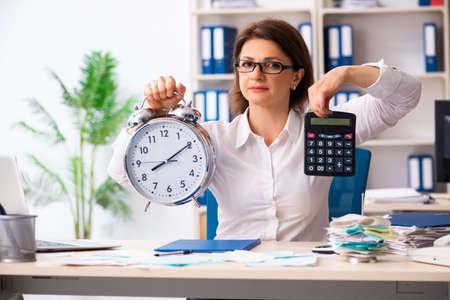 Photo pour Female employee in budget planning concept - image libre de droit