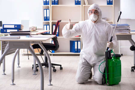 Photo for Professional contractor doing pest control at office - Royalty Free Image