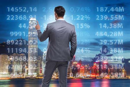 Photo pour Businessman in stock trading concept - image libre de droit