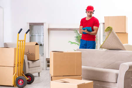 Photo for Young male contractor with boxes working indoors - Royalty Free Image