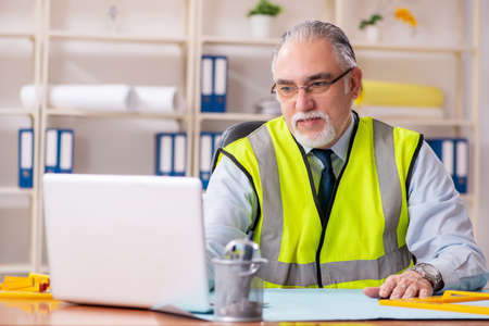 Photo for Aged construction engineer working in the office - Royalty Free Image
