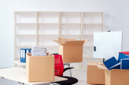 Photo for Young man employee with boxes in the office - Royalty Free Image