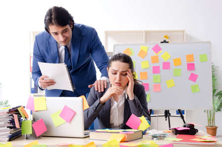 Photo pour Two colleagues employees working in the office - image libre de droit
