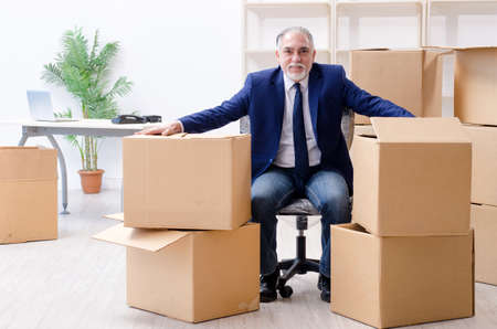 Photo for Aged businessman moving to new workplace - Royalty Free Image