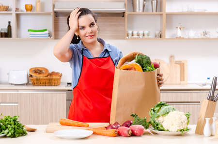 Photo for Young woman with vegetables in the kitchen - Royalty Free Image